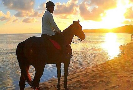 Horse riding on the beach at sunset in Mauritius